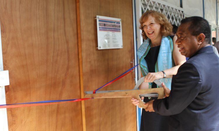 people cutting a ribbon